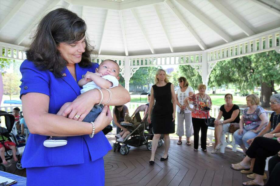 Senator Dante Bartolomeo, a mother of two sons,  holds 2 month old Luke Davila during the Diaper Drive at Veterans Memorial Gazebo at Union Park on the South Green. The Diaper Bank collected 700 to 800 diapers Wednesday morning as a part of National Diaper Need Awareness Week. The Diaper Bank provides diapers to Even Start, Early Head Start and the Nurturing Family Network at Middlesex Hospital and the Family Wellness Center at the Community Health Center, all in Middletown. Catherine Avalone - The Middletown Press Photo: Journal Register Co. / TheMiddletownPress