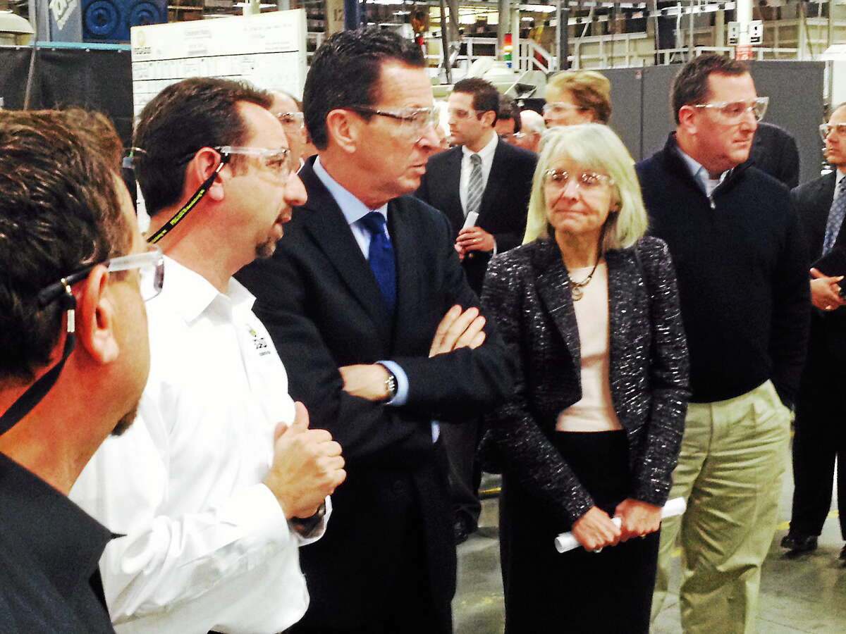Gov. Dannel P. Malloy tours the Pegasus Manufacturing facility with Pegasus President Chris DiPentima, left, and Economic Community Development Commissioner Catherine Smith in Middletown Wednesday.