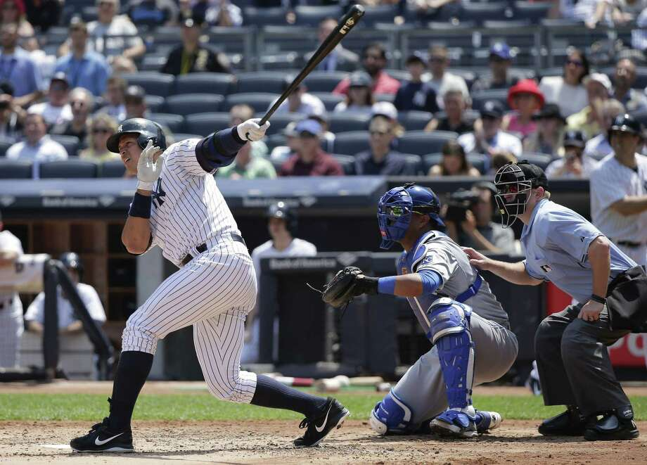New York Yankees designated hitter Alex Rodriguez follows through on a three-run home run in the third inning Wednesday in a win over the Kansas City Royals. Photo: Julie Jacobson — The Associated Press  / AP