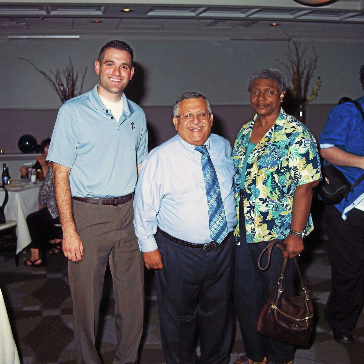 """Jeff Pugliese, left, and Jennifer De Kine, right, from the Middlesex County Chamber of Commerce, recently attended a retirement celebration for Rosario """"Riz"""" Rizzo, center, who is retiring from Pratt & Whitney after a long and distinguished career."""