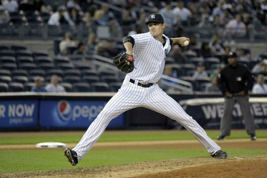 New York Yankees closer Andrew Miller delivers the ball to the Chicago White Sox during the ninth inning of a baseball game Saturday, Sept. 26, 2015, at Yankee Stadium in New York. Miller got the save as the Yankees defeated the White Sox 2-1.(AP Photo/Bill Kostroun) Photo: AP / FR51951 AP