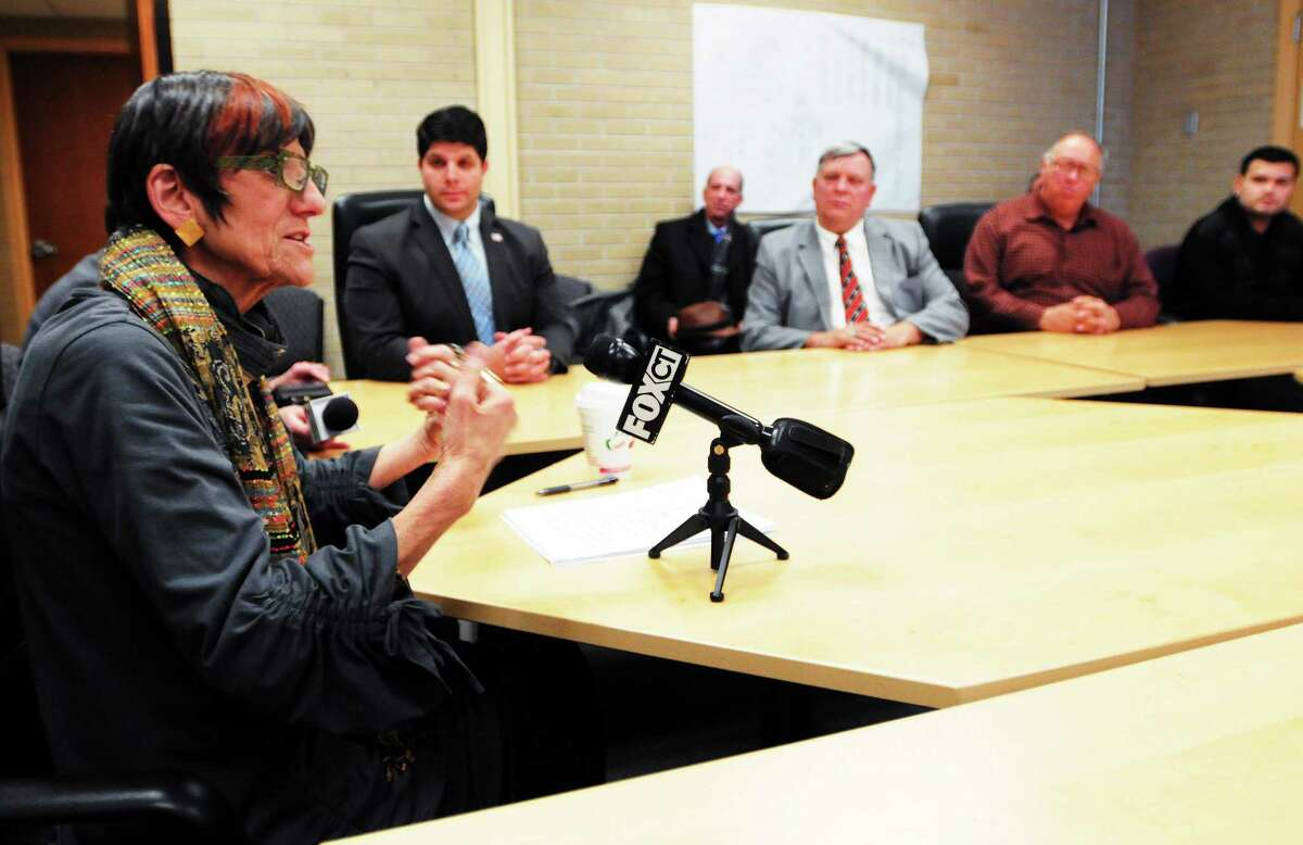 (Peter Hvizdak — New Haven Register) U.S. Rep. Rosa DeLauro has a conversation with constituents at Middletown City Hall in this December file photo.