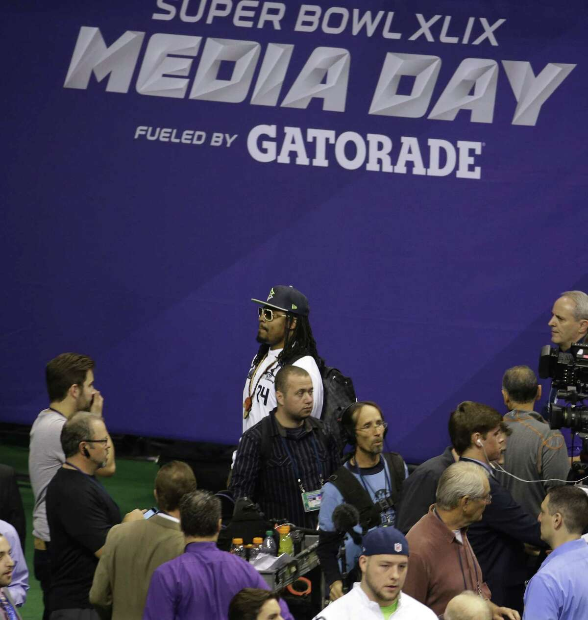 Seattle Seahawks running back Marshawn Lynch leaves at the beginning of Super Bowl media day on Tuesday in Phoenix.