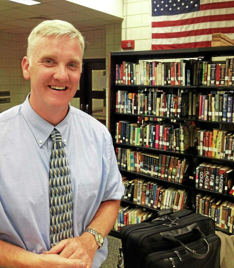 East Hampton's Assistant Superintendent of Schools Timothy Van Tasel told the school board this week he's accepted a position to head the Hebron School System. Photo: Jeff Mill — The Middletown Press