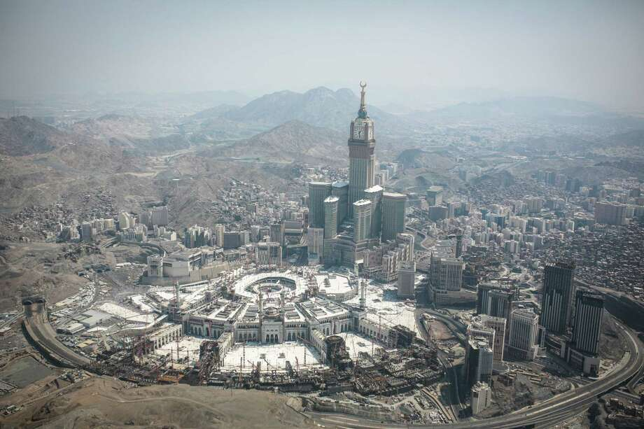 In this aerial photo made from a helicopter, the Abraj Al-Bait Towers with the four-faced clocks stands over the holy Kaaba, as Muslims encircle it inside the Grand Mosque, during the annual pilgrimage known as the hajj, in the Muslim holy city of Mecca, Saudi Arabia, Friday, Sept. 25, 2015. Photo: AP Photo/Mosa'ab Elshamy   / AP