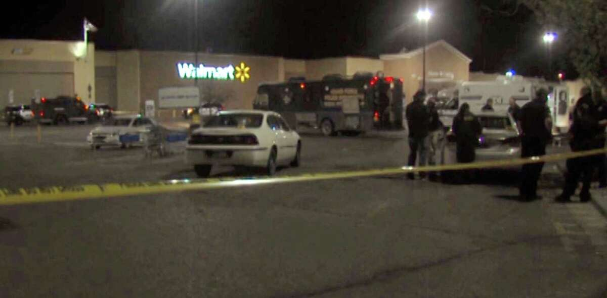 In this photo provided by WDAZ-WDAY TV Grand Forks-Fargo, police investigate the scene of a shooting at a Wal-Mart Supercenter store Tuesday, May 26, 2015, in Grand Forks, N.D. Grand Forks Police said the deadly shooting occurred a few minutes after 1 a.m. (Matt Henson/WDAZ-WDAY TV Grand Forks-Fargo via AP) MANDATORY CREDIT