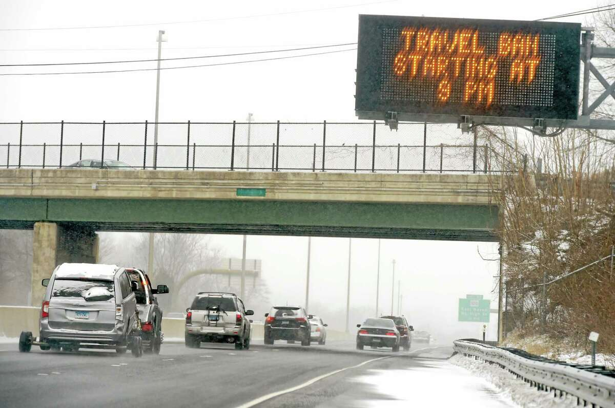 (Peter Hvizdak - New Haven Register) A sign on Interstate 95 informs motorists of the travel ban in Connecticut because of the blizzard forecast Monday afternoon January 26, 2015.