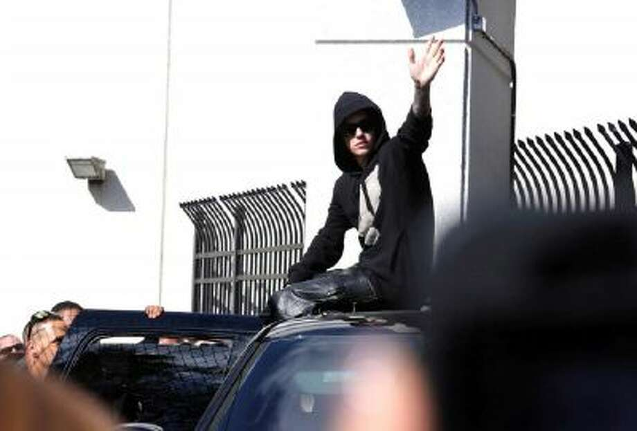 In this Jan. 23, 2014, file photo, singer Justin Bieber leaves the Turner Guilford Knight Correctional Center in Miami.