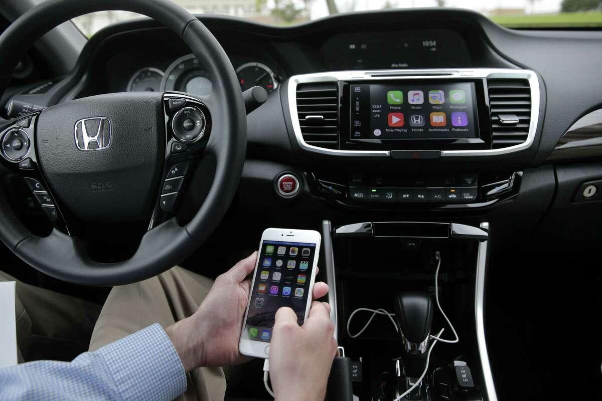 Chris Martin from Honda North America demonstrates Apple CarPlay in Torrance, Calif.