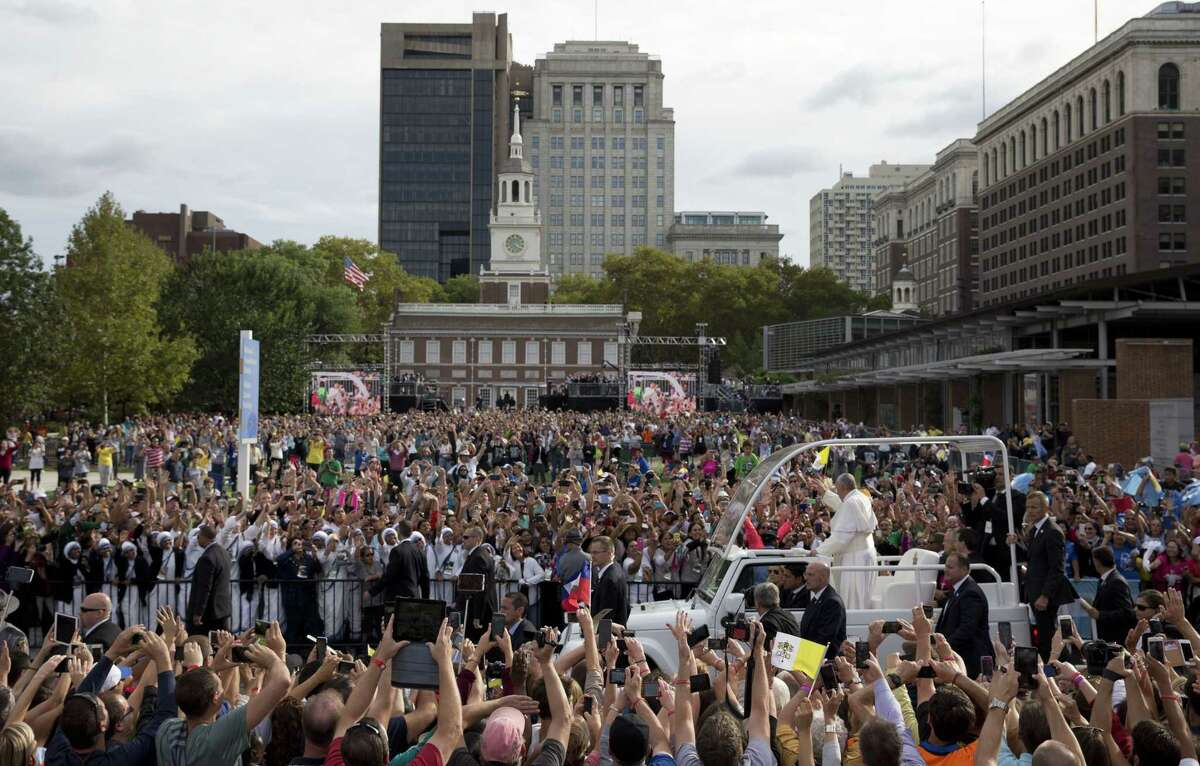 Pope Francis rides in the popemobile along Independence Mall before delivering a speech outside Independence Hall Saturday, Sept. 26, 2015, in Philadelphia.