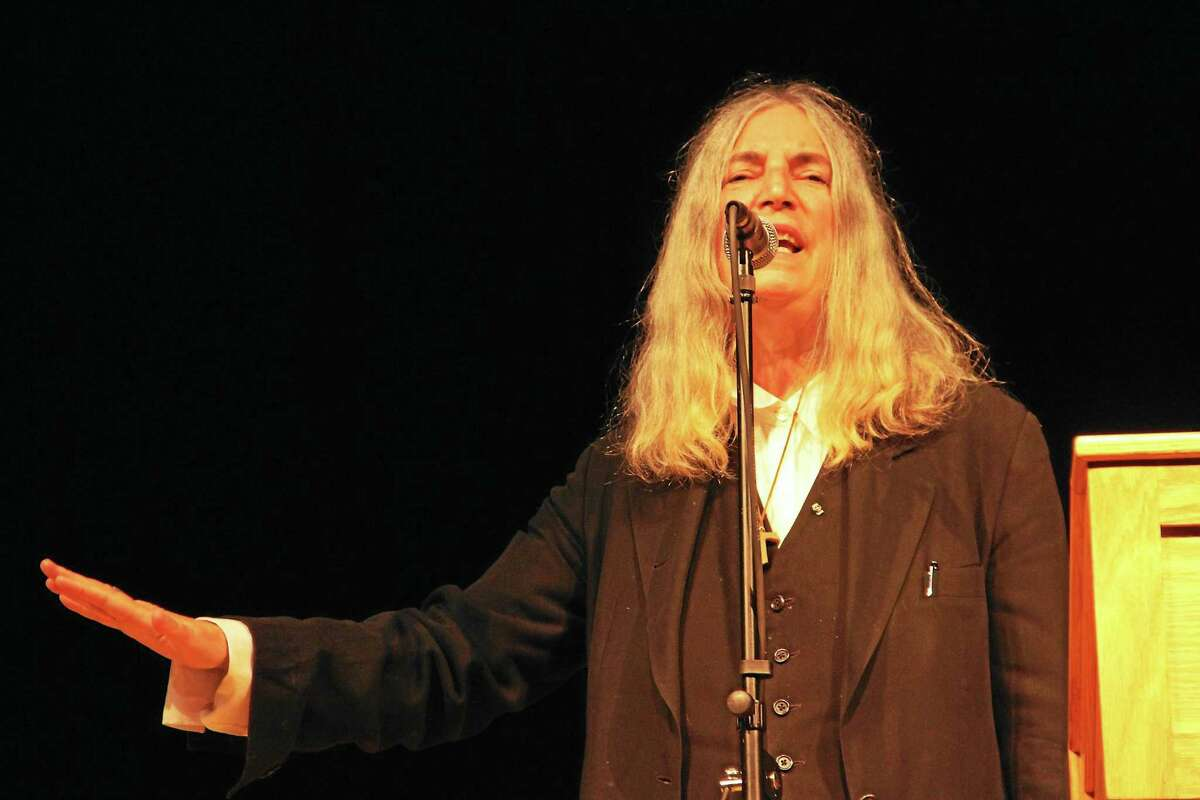 Rock and Roll Hall of Fame inductee Patti Smith performs during the American Museum of Tort Law convocation ceremony held Saturday in the Gilbert High School auditorium.