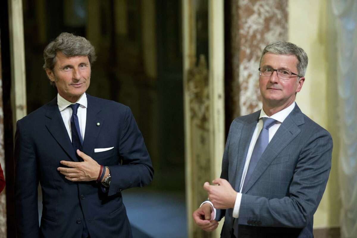 The CEO of Audi, Rupert Stadler, right, and Automobili Lamborghini President and Chief Executive Officer Stephan Winkelmann pose for photographers at Rome's Palazzo Chigi Government office, Wednesday, May 27, 2015. (AP Photo/Alessandra Tarantino)