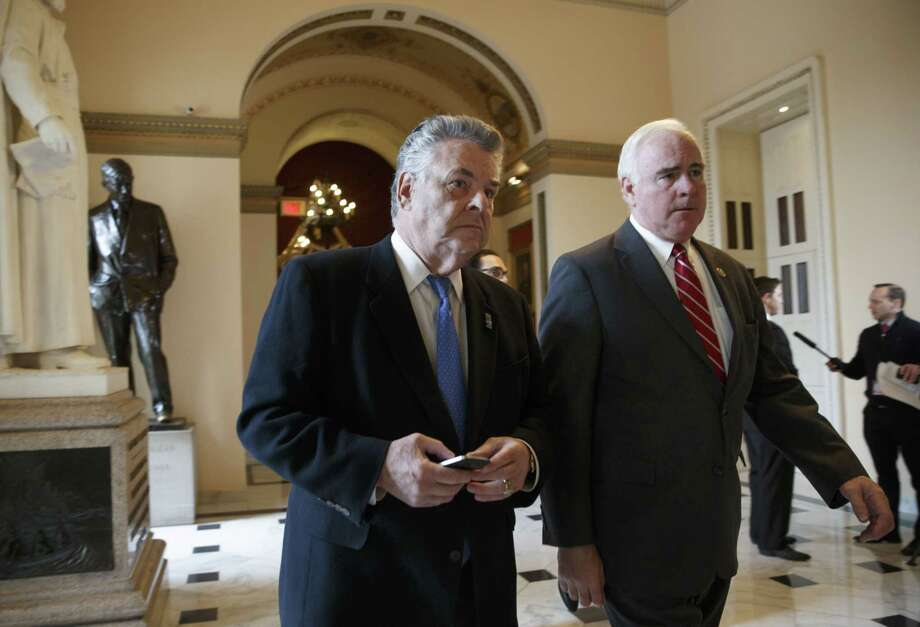 Rep. Peter King, R-N.Y., left, and Rep. Pat Meehan, R-Pa., head to the House chamber on Capitol Hill in Washington. Photo: AP Photo/J. Scott Applewhite  / AP