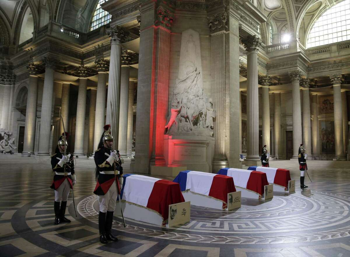Four flag-draped coffins are seen inside the Pantheon as part of an induction ceremony in Paris, France, Wednesday, May 27, 2015. France is honoring four people who resisted the Nazis during World War II by inducting them into Paris' Pantheon mausoleum, in a rare and highly symbolic ceremony aimed at uniting the French against extremism and anti-Semitism. The French resistance figures are Pierre Brossolette, Germaine Tillion, Genevieve de Gaulle-Anthonioz and Jean Zay. (Philippe Wojazer/Pool Photo via AP)