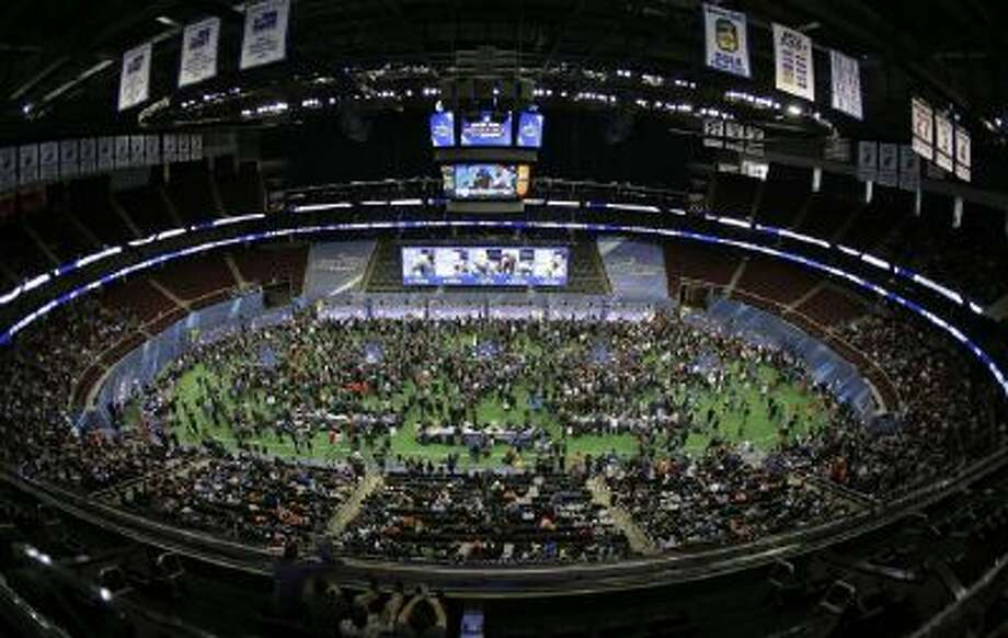 Reporters crowd the floor of the Prudential Center during media day for the NFL Super Bowl XLVIII football game Tuesday, Jan. 28, 2014, in Newark, N.J.
