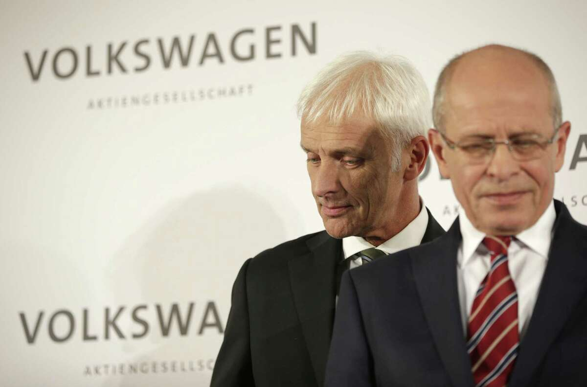 Newly appointed Volkswagen CEO Matthias Mueller, left, passes by Berthold Huber, acting chairman of the supervisory board, prior to a press statement after a meeting of Volkswagen's supervisory board in Wolfsburg, Germany, Friday, after CEO Martin Winterkorn resigned on Wednesday amid an emissions scandal.