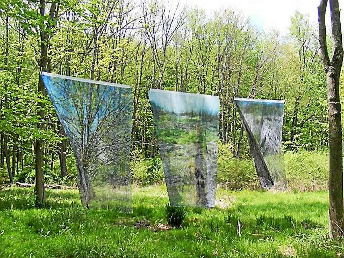 """Marion Belanger's """"Landfill"""" is a photographic installation that consists of three photographs printed on silk, suspended in trees. The piece was commissioned by Wesleyan University's Center for the Arts and Environmental Studies Program."""