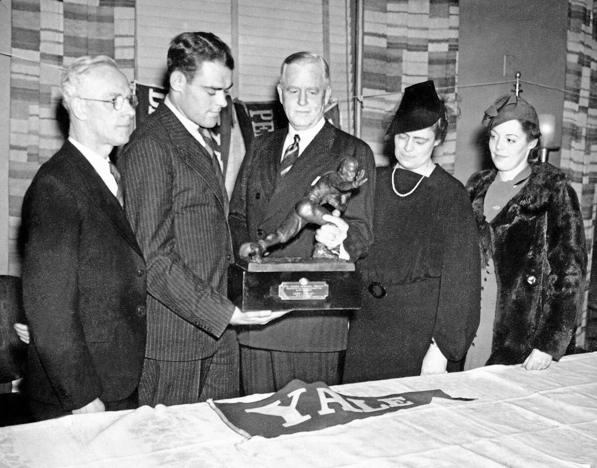 Yale end Larry Kelley, second from left, won the Heisman Trophy on Dec. 16, 1936 in New York.