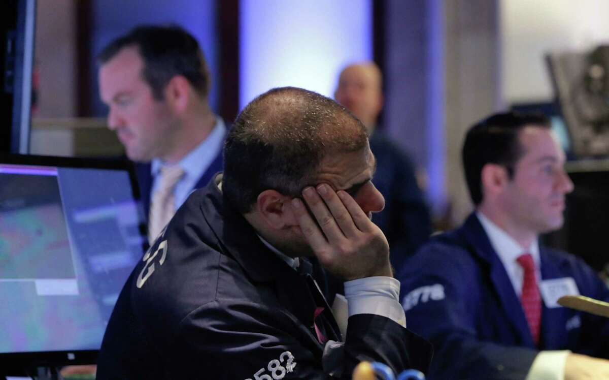 Specialists work on the floor of the New York Stock Exchange Tuesday.