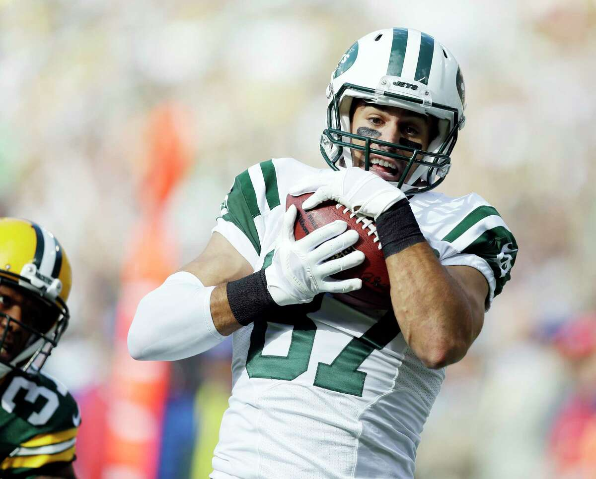 New York Jets receiver Eric Decker catches a touchdown pass during the first half of a Sept. 14 game against the Packers in Green Bay, Wis.
