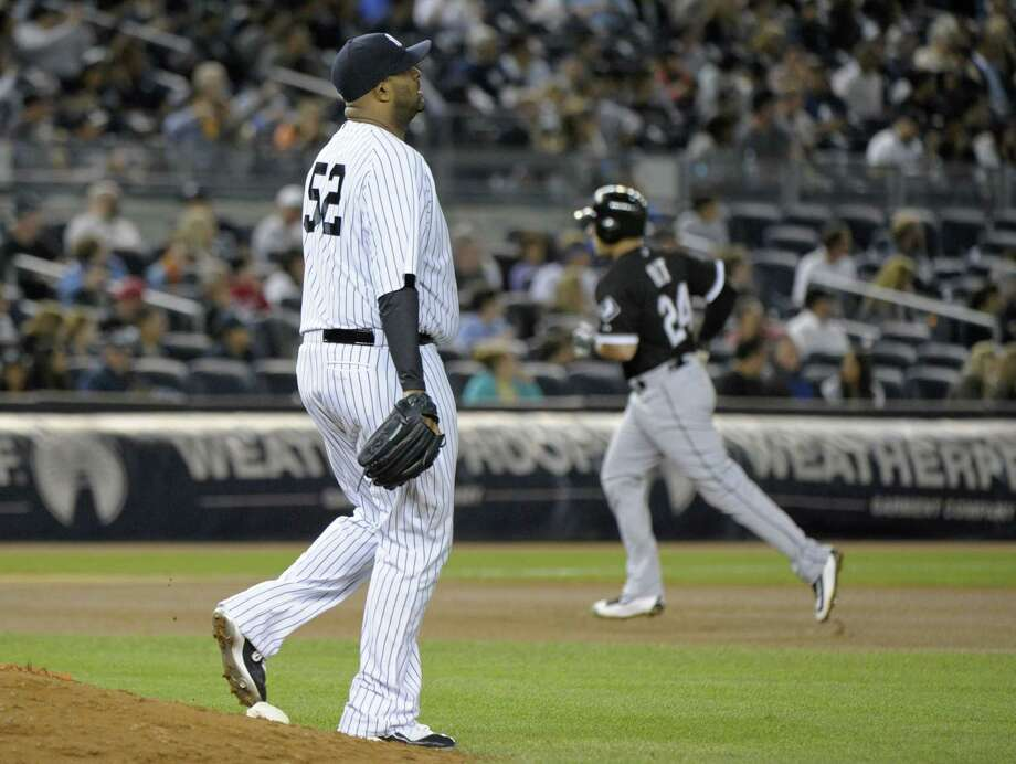 Yankees pitcher CC Sabathia reacts as the White Sox's Mike Olt, right, rounds the bases with a home run during the seventh inning Friday. Photo: Bill Kostroun — The Associated Press  / FR51951 AP