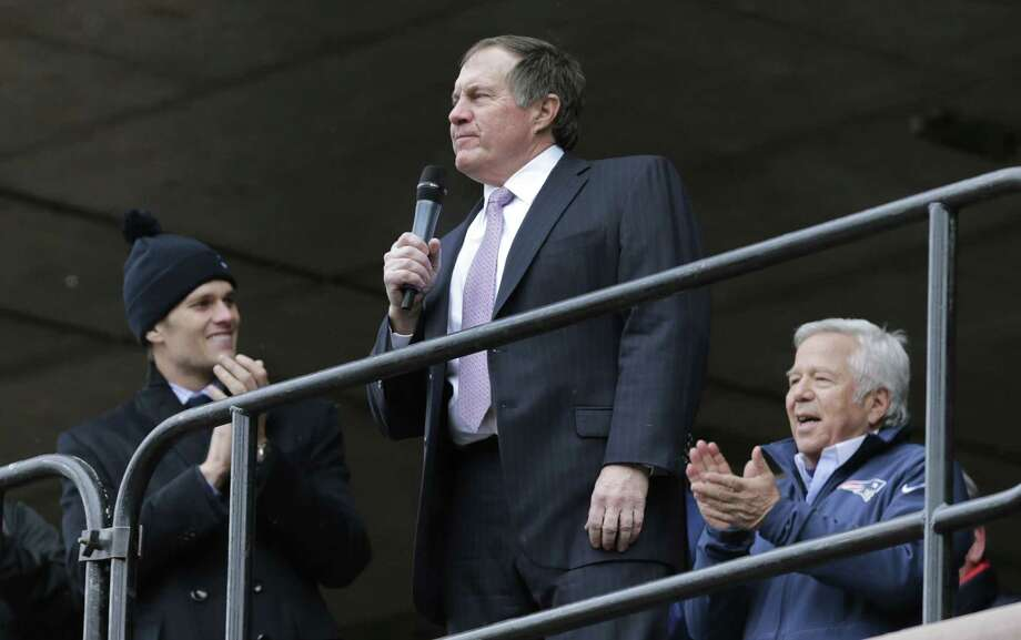 Patriots head coach Bill Belichick, center, addresses a crowd of supporters during a sendoff rally at City Hall in Boston on Monday. Photo: Charles Krupa — The Associated Press  / AP