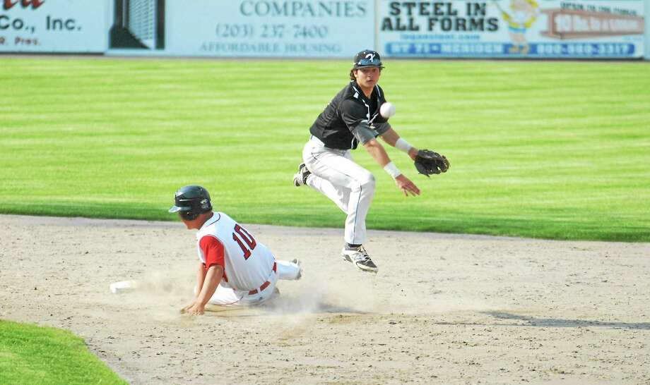 Xavier shortstop Laurence Hill tries for a double-play as Cheshire's Ethan Lonardelli (10) slides into second at Palmer Field. Photo: Jimmy Zanor — Middletown Press