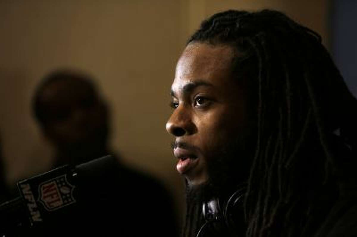 Richard Sherman speaks during a news conference Sunday, Jan. 26, 2014, in Jersey City, N.J.