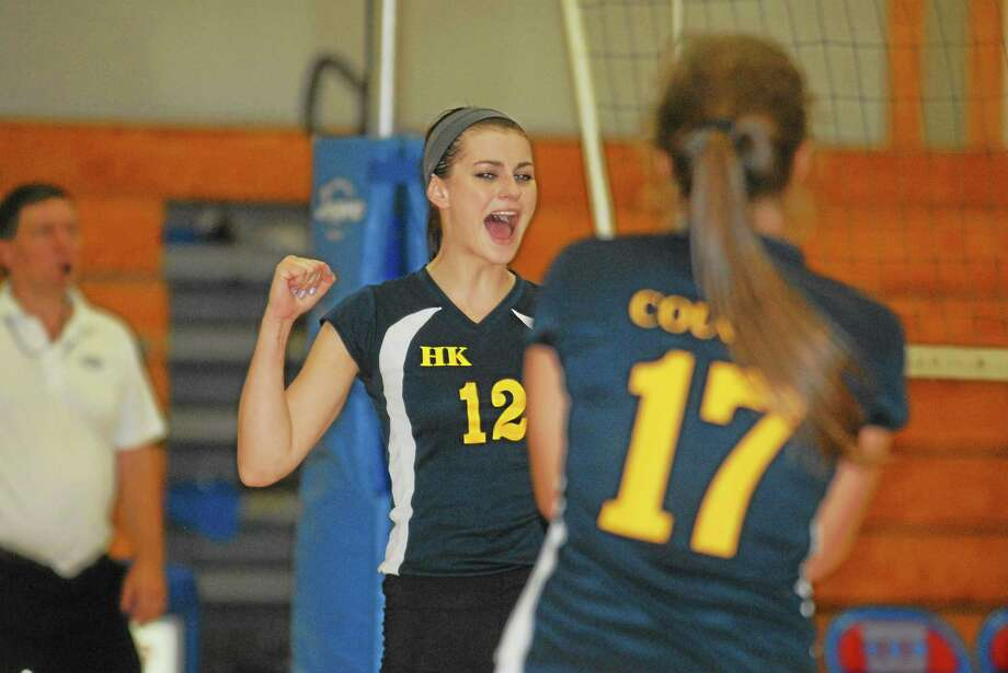 Haddam-Killingworth senior Lauren Brough celebrates after the Cougars earned a point Thursday against Coginchaug. Photo: Jimmy Zanor — Middletown Press