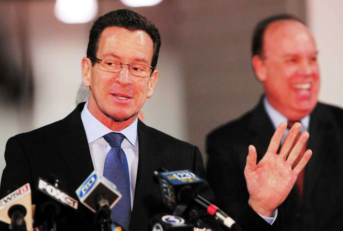 Gov. Dannel P. Malloy and state Rep. Steve Dargan are seen at a press conference in West Haven.