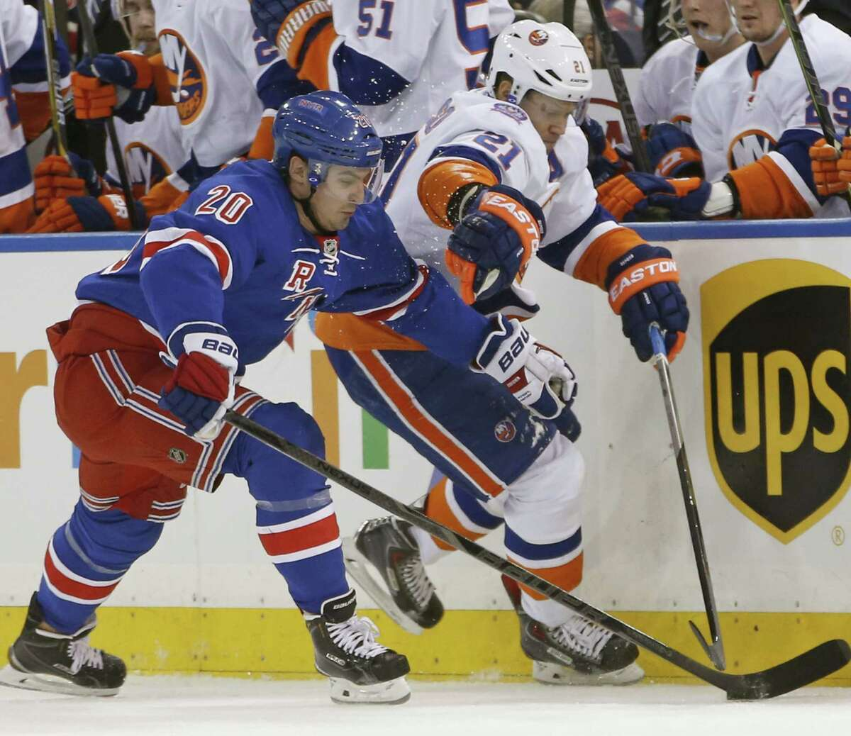 Rangers left wing Chris Kreider (20) fends off New York Islanders right wing Kyle Okposo (21) during a Jan. 13 game at Madison Square Garden in New York.