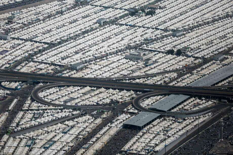 Tents for pilgrims attending the annual hajj pilgrimage are seen from a helicopter over Mina, Saudi Arabia, in Friday, Sept. 25, 2015, a day after a stampede killed more than 700 people. Saudi authorities are investigating what sparked Thursday's disaster in Mina, about 5 kilometers (3 miles) from Mecca. Initial reports suggested two crowds coming from opposing directions converged on an intersection, which began pushing and shoving until a stampede began. Photo: AP Photo/Mosa'ab Elshamy   / AP