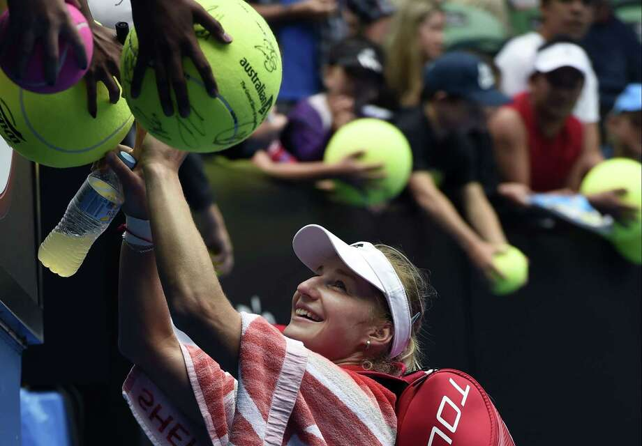 Ekaterina Makarova signs autographs for fans after defeating Simona Halep in their quarterfinal match at the Australian Open on Tuesday in Melbourne. Photo: Andy Brownbill — The Associated Press  / AP