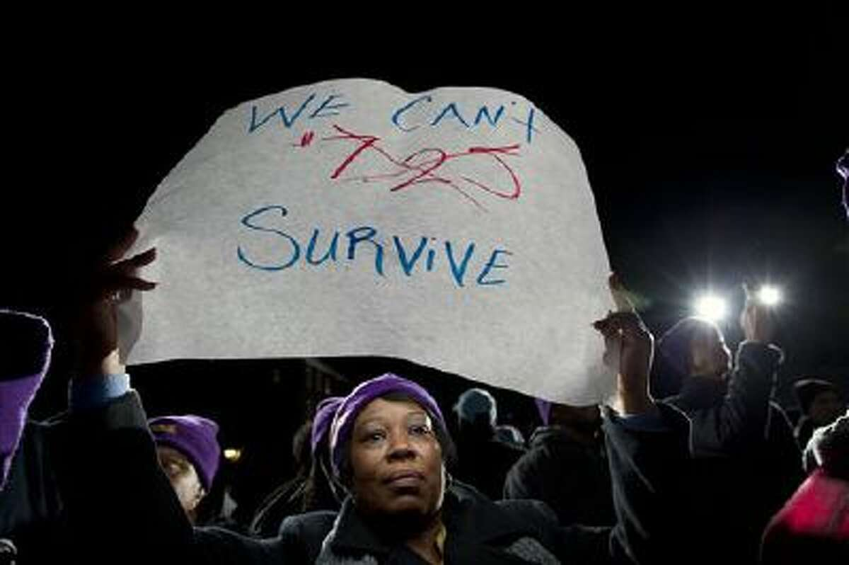 Darlene Handy of Baltimore holds up a banner during a rally Jan. 14 supporting a higher minimum wage.
