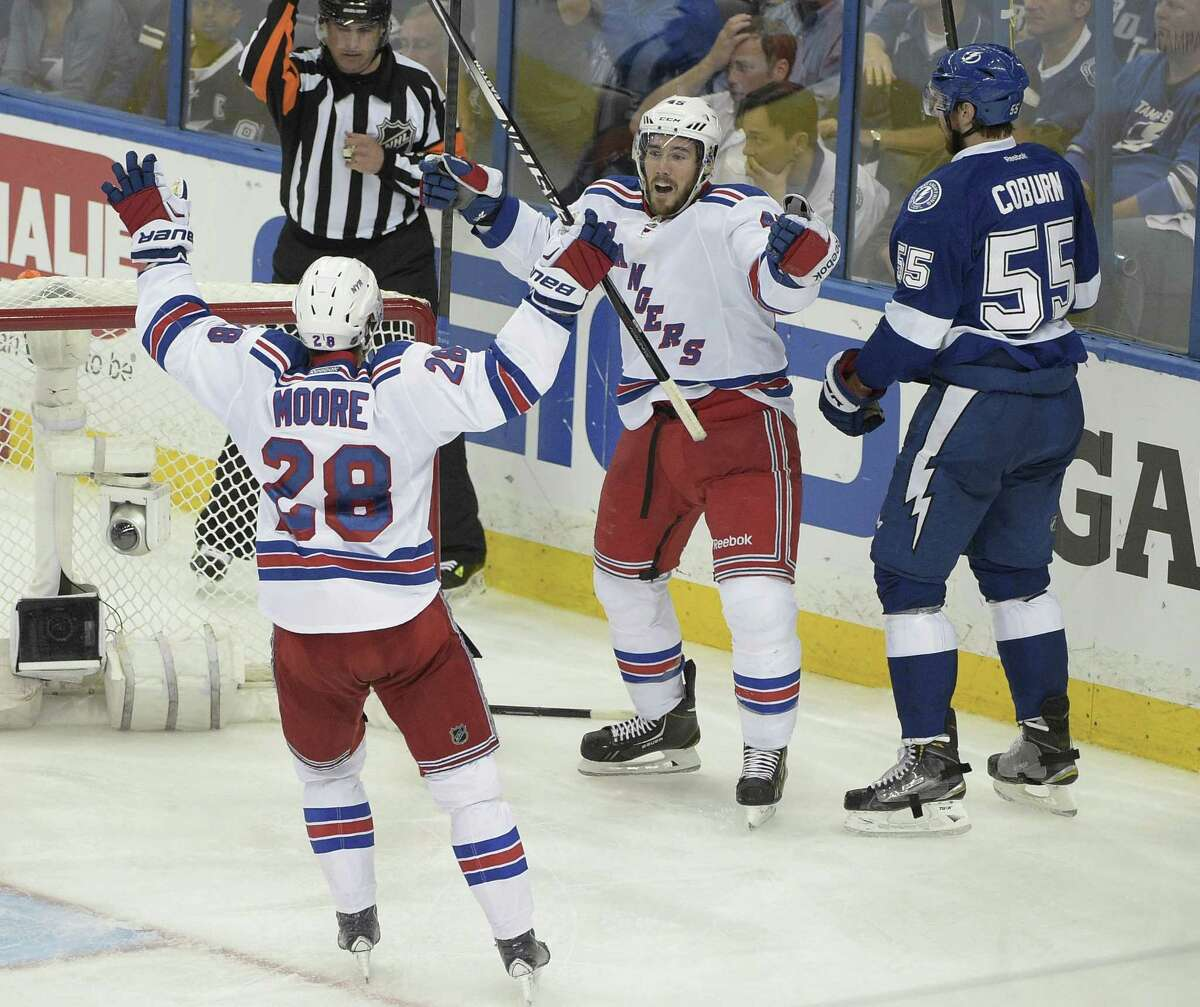 New York Rangers left wing James Sheppard, center rear, celebrates his goal with center Dominic Moore (28) during the third period of Game 6 of the Eastern Conference finals against the Tampa Bay Lightning.