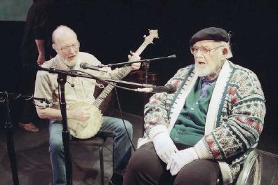 This May 1993 file photo shows Pete Seeger, left, age 74, who hadn't sung with Burl Ives, right, age 84, for at least 40 years, singing together in rehearsal at New York's 92nd St., Y. The American troubadour, folk singer and activist Seeger died Monday Jan. 27, 2014, at age 94.