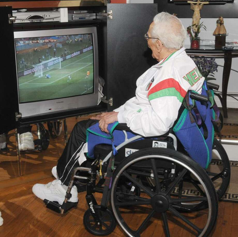 Elias Oropeza, 99, of New Fairfield, watches soccer playoff updates on TV, on Tuesday, June 15, 2010. Photo: Jay Weir / The News-Times Freelance