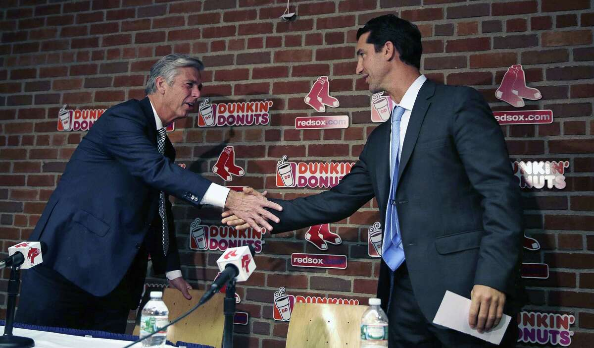Red Sox newly appointed General Manager Mike Hazen, right, smiles as he is congratulated by President of Baseball Operations Dave Donbrowski at Fenway Park in Boston on Thursday.