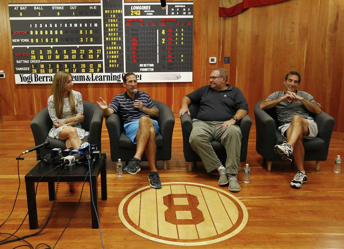 Yogi Berra's oldest granddaughter Lindsay Berra, far left, sits with his sons, from left, Dale, Larry and Tim while talking about the passing of the New York Yankees hall of fame catcher at the Yogi Berra Museum Thursday in Little Falls, N.J.