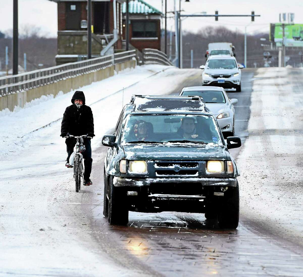 (Arnold Gold-New Haven Register) A man bicycles over the Washington Bridge from Stratford to Milford on 1/27/2015.