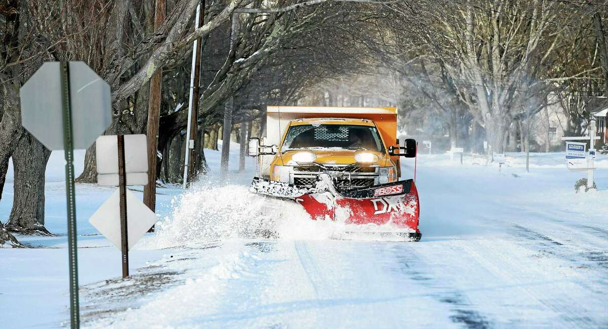 (Arnold Gold-New Haven Register) A plow clears the snow off of West Wharf Rd. in Madison on 1/9/2015.