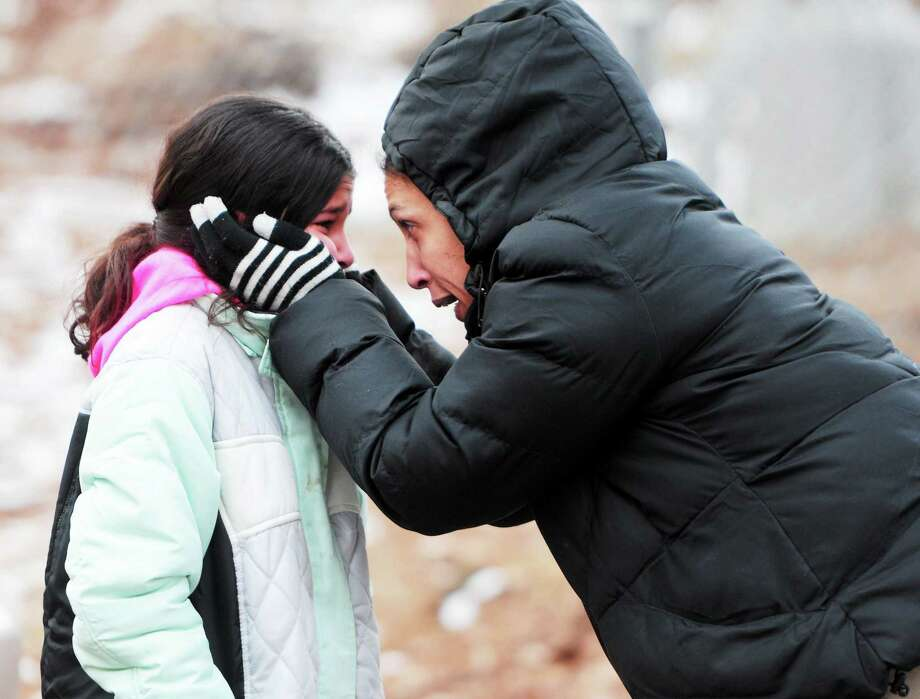 (Photo by Peter Hvizdak ó New Haven Register) Chloe Marcuccio tries to console her daughter Juliet, 11, after a 2-alarm fire raged through their house Tuesday  afternoon  January 28, 2014 at 104 Hickory Lane in Cheshire, Connecticut Photo: New Haven Register / ©Peter Hvizdak /  New Haven Register