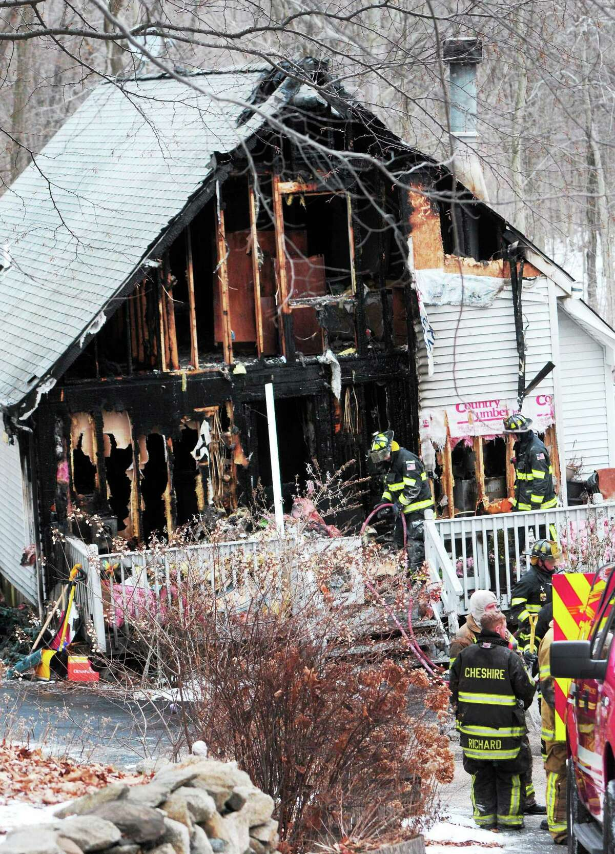 (Photo by Peter Hvizdak ó New Haven Register) 2-alarm fire Tuesday afternoon that displaced a family January 28, 2014 at 104 Hickory Lane in Cheshire, Connecticut