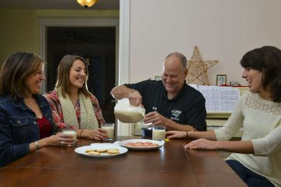 The Gores, Hilda, left, with daughter Rebeca, husband Mitch and daughter Emilia, drink raw milk. Hilda Gore says she found it a natural progression in her move away from processed foods.