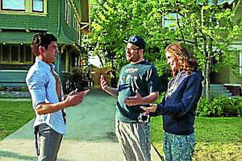 "Zac Efron, from left, Seth Rogen and Rose Byrne star in ""Neighbors."" Photo: (Glen Wilson — Universal Pictures)"