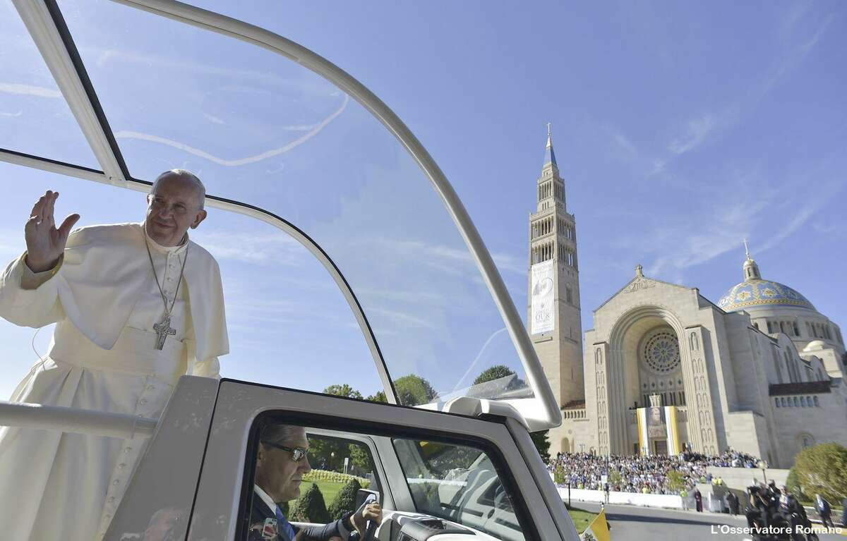 In this photo taken Sept. 23, 2015, Pope Francis arrives to celebrate an outdoor Mass at the Basilica of the National Shrine of the Immaculate Conception in Washington to canonize Junipero Serra.
