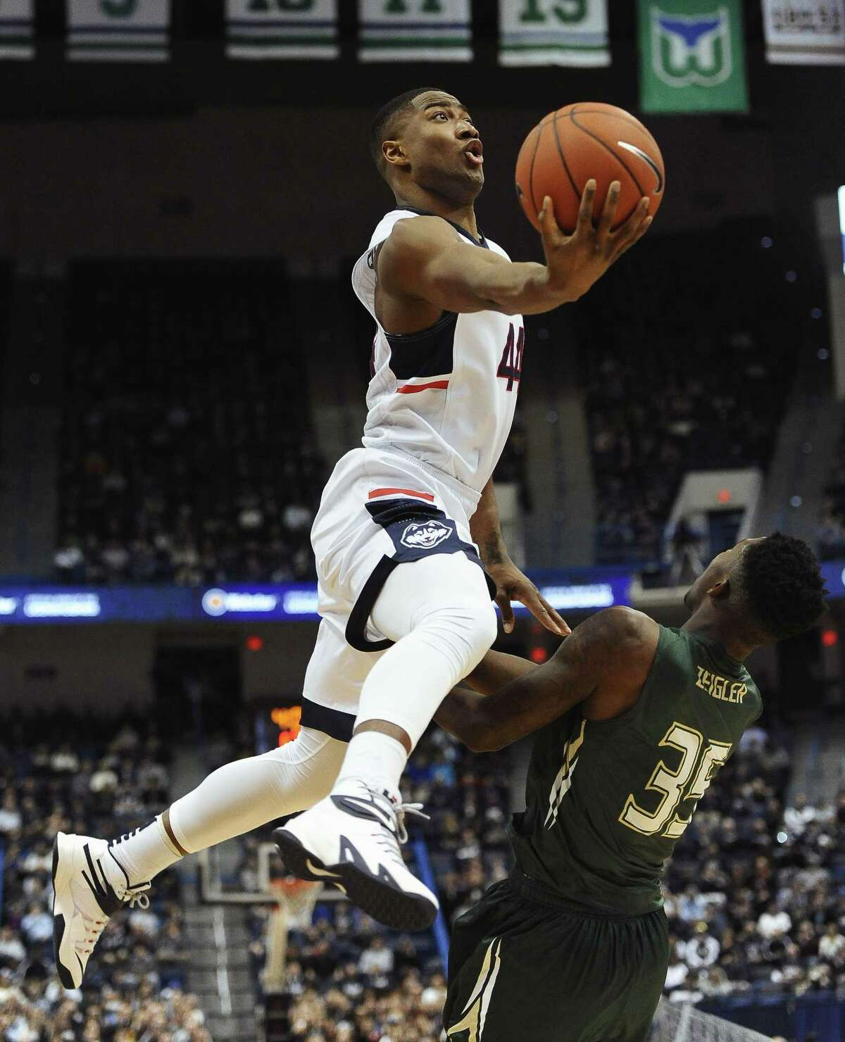 UConn's Rodney Purvis, left, shoots over South Florida's Bo Zeigler during the first half Sunday.