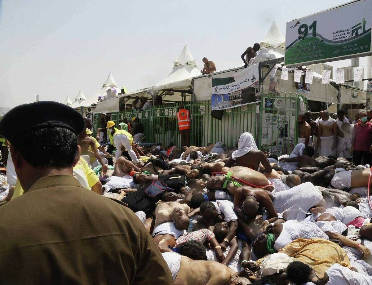 Muslim pilgrims and first responders gather around bodies of people crushed in Mina, Saudi Arabia during the annual hajj pilgrimage on Thursday, Sept. 24, 2015. Hundreds were killed and injured, Saudi authorities said. The crush happened in Mina, a large valley about five kilometers (three miles) from the holy city of Mecca that has been the site of hajj stampedes in years past.