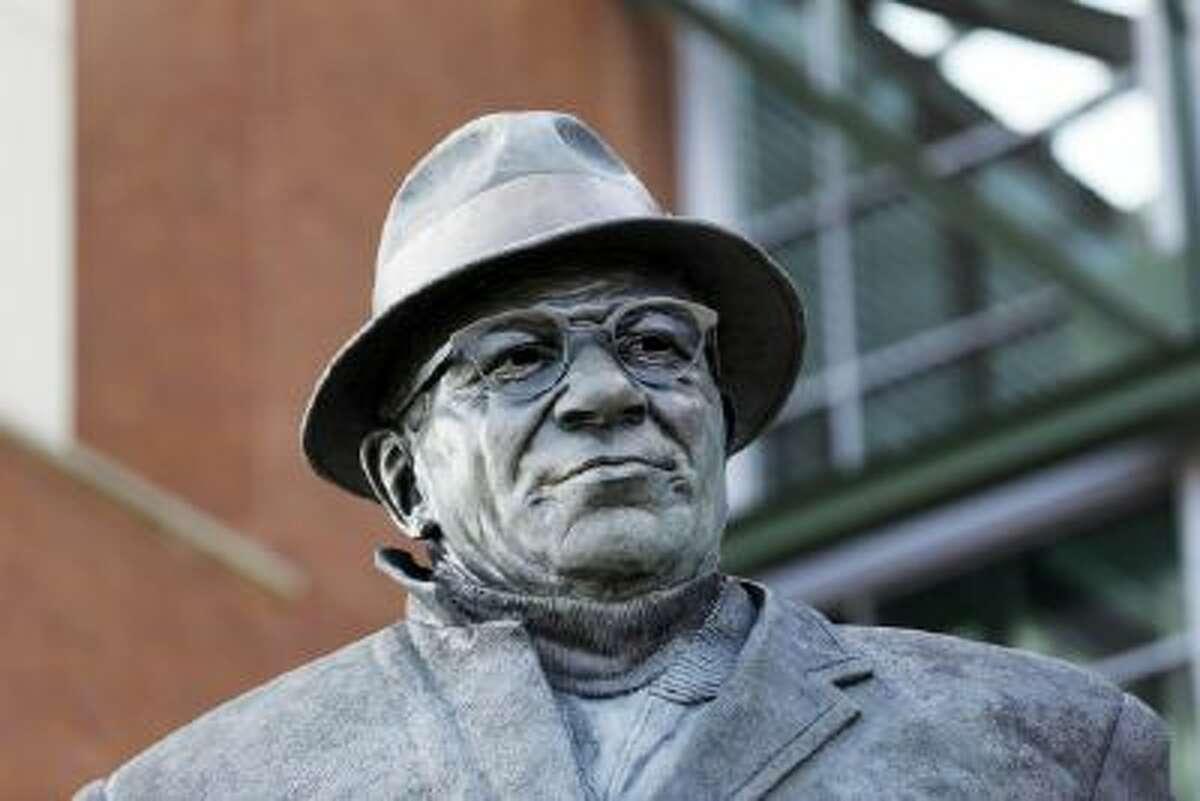 A statue of Vince Lombardi is seen outside Lambeau Field in Green Bay, Wis.