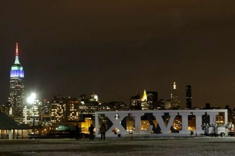 Roman numerals for NFL Super Bowl XLVIII football game are erected at Pier A Park in Hoboken, N.J., with the New York City skyline, including the Empire State Building, left. The New York-New Jersey area is hosting its first Super Bowl Feb. 2.